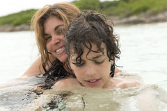 Single mother and son in a tropical beach Royalty Free Stock Photo