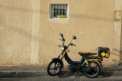 Single motorcycle in the street. Old motorcycle in the street Stock Image