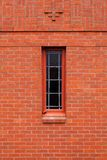 Single narrow window in brick wall Royalty Free Stock Photos