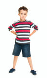 Single naughty little boy standing Royalty Free Stock Photos