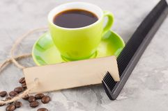 Single new black plastic comb and old blank rectangle paper with hole and long rope beside full cup of black coffee and lot of sca stock photos