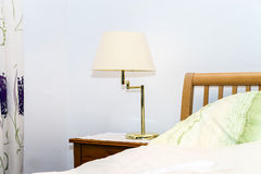 Single night lamp in bedroom Stock Images