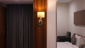 Single night lamp near dressing table. Single night lamp attached in bedroom near dressing table in resort Stock Image