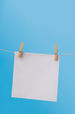 Single Note Paper on Washing Line against Blue Sky Stock Images