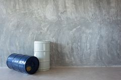 Single Oil Barrel on Bare cement wall. Detail royalty free stock photo