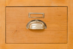 A single old cabinet drawer with metal handle. A single wooden drawer from an old almost vintage cabinet Royalty Free Stock Photography