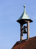 Single old church bell under canopy on roof Royalty Free Stock Image