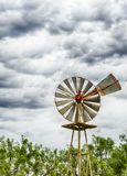 Single old historic wind wheel or wind pump made of wood and metal up close. A detailed view of a single old historic wind wheel or wind pump made of wood and stock images