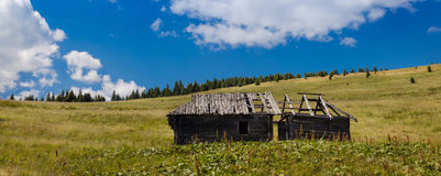 Single old house in a mountains landscape Stock Photography