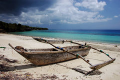 Single old wooden ship on the beach in Zanzibar