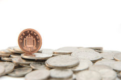 Single one pence piece. One pence piece standing on silver coins Royalty Free Stock Image