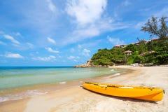 Single orange kayak on the shore of sea side Stock Photo