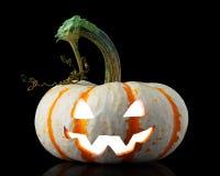 Free Single Orange Striped Pumpkin Jack-o-lantern On Black Royalty Free Stock Photography - 160589337