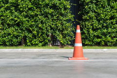 Single orange traffic cone on concrete street road Royalty Free Stock Photos