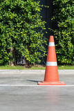 Single orange traffic cone on concrete street road Stock Photos