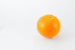 Single orange on white background. Single orange on white background concept Royalty Free Stock Image