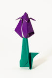 Single origami flower. Folded pieces of paper in the shape of a flower Stock Image