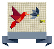 Single Origami hummingbird over textile pattern Royalty Free Stock Images
