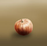 Single painted apple. Simple painting of an apple lying on the brown surface Stock Photos