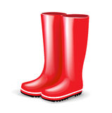 Single pair of red rubber boots Stock Photos