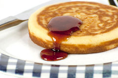 Single pancake on a plate. S isolated on a white background Royalty Free Stock Image