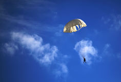 Single parachute jumper against blue sky background Royalty Free Stock Photos