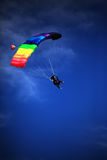 Single parachute jumper against blue sky background Royalty Free Stock Images