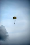 Single parachute jumper against blue sky background Stock Photography