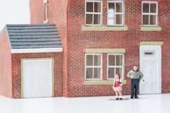 Single parent family concept with model people and house on whit Stock Image