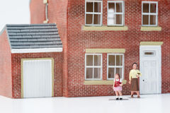Single parent family concept with model people. And house on white background stock photography