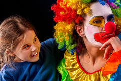 Single parent family. Mom after work birthday clown angry child. Single parent family. Tired mom after work as clown on birthday on dark background. Mother stock photography