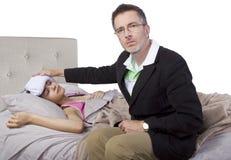 Single Parent And Sick Daughter Stock Image