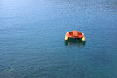 Single Pedalo at anchor. Stock Photography