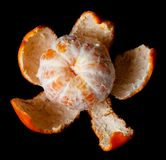 Single peeled mandarin Royalty Free Stock Photo