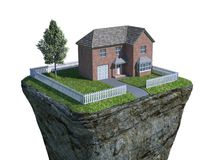 Single perched house. A single house perched on a column of rock Stock Photos
