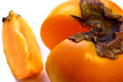Single Persimmon Fruit (Diospyros kaki) chopped Stock Images