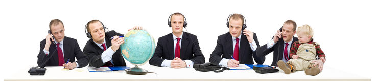 Single person customer service. A single person's call center of a self employed businessman answering various questions by telephone. A conceptual image of Stock Photography