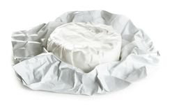 Single piece of camembert. In opened paper package stock photos