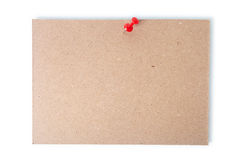 Single piece of cardboard pinned with a thumb tack with clipping path. Stock Images