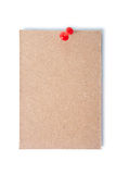 Single piece of cardboard pinned with a thumb tack with clipping path. Royalty Free Stock Images