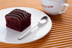 A single piece of chocolate cake Stock Images