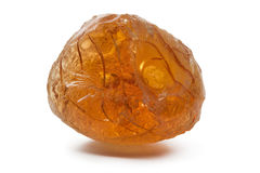 Single piece of Gum arabic. On white background royalty free stock images