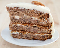 A single piece of Hummingbird cake with pecans Royalty Free Stock Photography