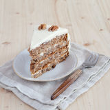 A single piece of Hummingbird cake with pecans Stock Photography