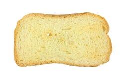 Single piece of melba toast. A single piece of melba toast on a white background royalty free stock image