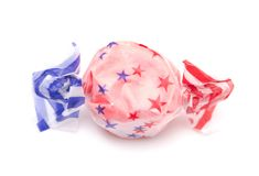Single Piece of Red Patriotic Salt Water Taffy. On a White Background royalty free stock photos
