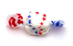 Single Piece of White Patriotic Salt Water Taffy. On a White Background stock photography