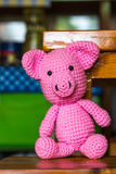 Single pig doll on a wood desk Royalty Free Stock Photo