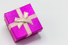 Single pink gift box with silver ribbon on white background. Merry christmas, happy new year festival,valentine day concept Stock Photo