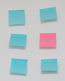 Single pink post it note in sea of blue post notes. Single pink post it note in sea of blue post it notes Stock Image